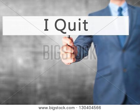 I Quit - Businessman Hand Holding Sign