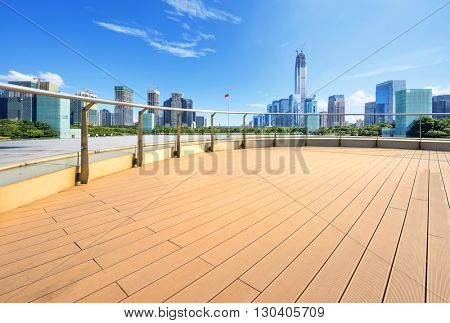 cityscape and skyline of hangzhou on view from empty floor