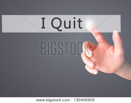 I Quit - Hand Pressing A Button On Blurred Background Concept On Visual Screen.