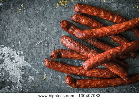 Chorizo Sausages on old metal background right horizontal