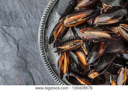 Open sash mussels on an old metal plate horizontal