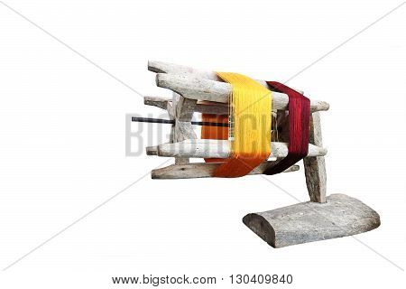 Thai silk reel hand made craft old-fashioned retro wooden isolated on white background