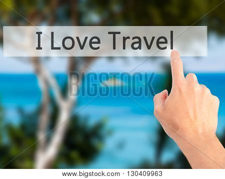 I Love Travel  - Hand Pressing A Button On Blurred Background Concept On Visual Screen.