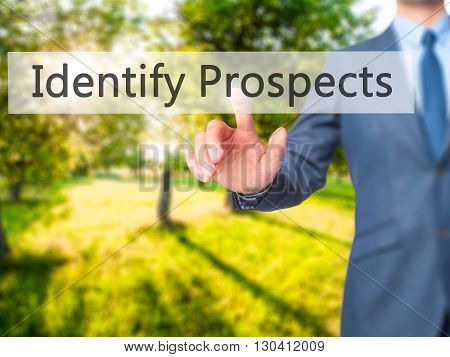 Identify Prospects - Businessman Hand Pressing Button On Touch Screen Interface.