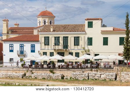 Athens Greece - April 30 2016: Church and traditional buildings and restaurants near Roman Forum Athens.