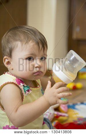 Baby Girl Holding Bottle
