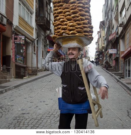 Istanbul Turkey -January 3 2015: A vendor sells simit a type of Turkish bread in the streets of Istanbul.