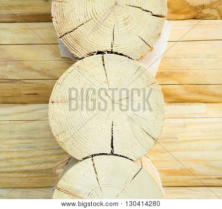 wall of the house of round wooden logs