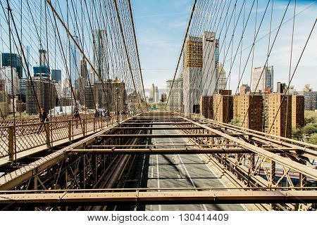 NEW YORK, USA - MAY 16, 2016: Brooklyn Bridge in New York. The Brooklyn Bridge is a hybrid cable-stayed/suspension bridge in New York City and is one of the oldest bridges in the USA.