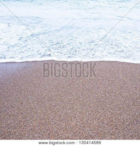 Sea foam on the beach. Abstract nature for background