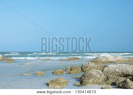 Landscape shot. Rocks and sea waves on the beach
