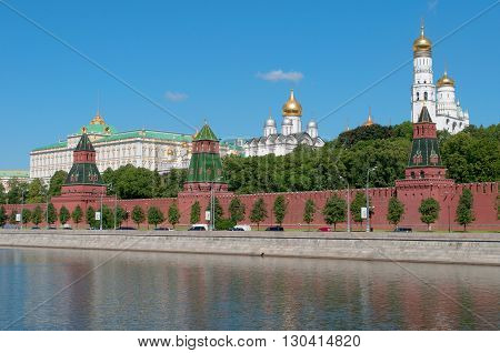 MOSCOW, RUSSIA - JUNE 05, 2012: Kremlin embankment and tower of the Moscow Kremlin on a sunny june day. The landmark of Russia