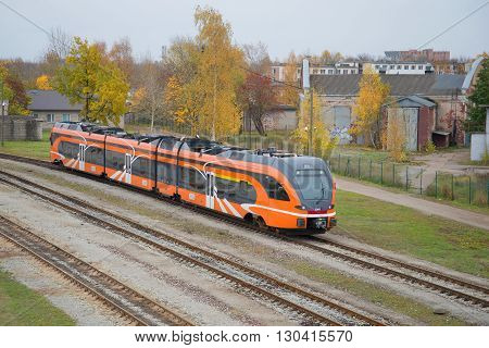 NARVA ESTONIA - OCTOBER 12, 2014: A modern passenger diesel train on the line at Narva
