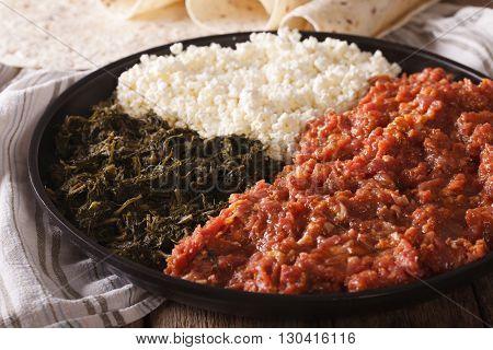Ethiopian Kitfo With Herbs And Cheese Ayibe And Injera Close-up. Horizontal
