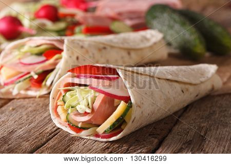 Sandwich Roll With Ham And Fresh Vegetables Macro. Horizontal
