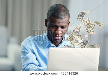 Financial concept. Make money on the Internet. African American businessman working with laptop, close up