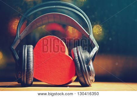 Decorative heart and headphones on lights background