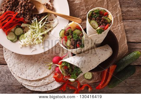 Burritos With Minced Meat And Fresh Vegetables Close-up. Horizontal Top View
