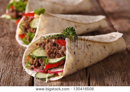 Burritos With Minced Meat And Fresh Vegetables Close-up. Horizontal