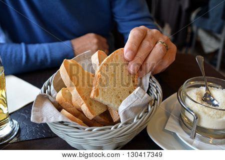 Man has on a hand italian bread ciabatta
