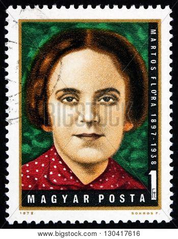 HUNGARY - CIRCA 1972: a stamp printed in Hungary shows Flora Martos Hungarian Labor Party Leader circa 1972