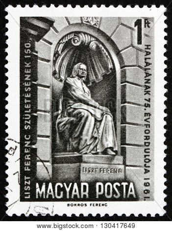 HUNGARY - CIRCA 1961: a stamp printed in Hungary shows Liszt Monument Budapest 150th Anniversary of the Birth and 74th Anniversary of the Death of Franz Liszt Composer circa 1961