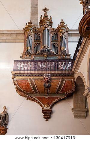 Santo Tirso, Portugal. December 26, 2015: Baroque pipe-organ in the Sao Bento monastery. Benedictine order.