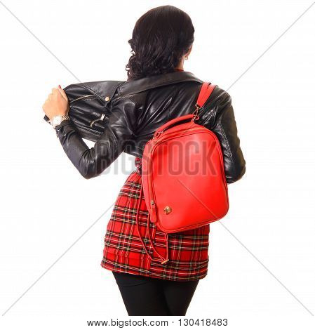 young woman back with red bag in black leather jacket white background