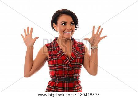 Funky emotions. Beautiful young women making a face while standing white background