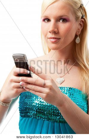 Charming girl reads sms on mobile phone