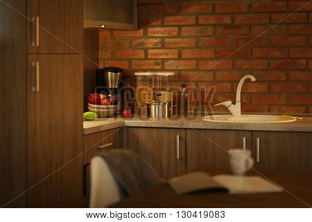 Modern kitchen furniture with sink and utensils