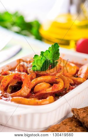 Stewed Squid Rings With Tomato Sauce In White Plate