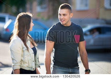 Young Man And Woman Walking On The Street