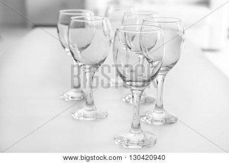 Wineglasses on blurred interior background