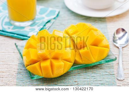 Healthy breakfast Fresh tropical fruit mango and orange juice, coffee on a outdoor tropical background