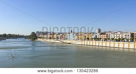 Panoramic view of Triana quarter waterfront on the left bank of Guadalquivir river, Seville, Spain.