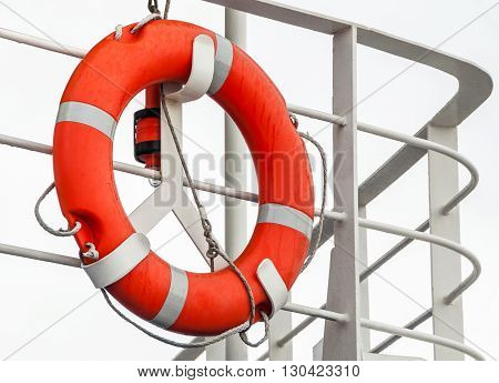 Lifebuoy on a ship railing . .