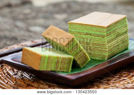 Traditional Indonesian sweet Lapis layer cake on a wooden background