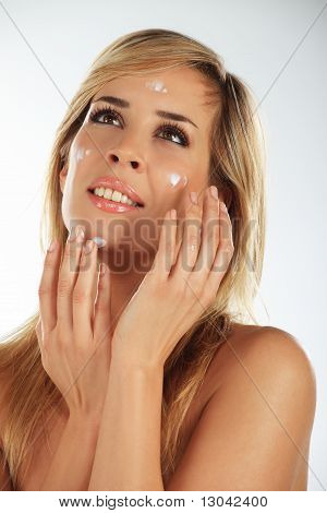 Girl Applying Creme