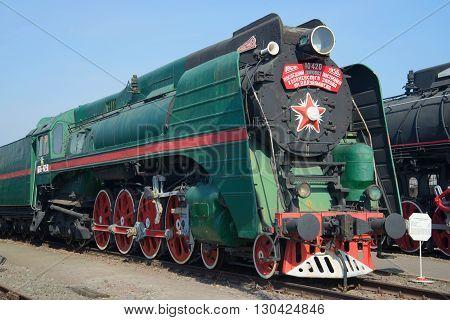 SAINT PETERSBURG, RUSSIA - MARCH 30, 2016: Vintage Soviet passenger steam locomotive P-36 closeup on the railway. Historical landmark