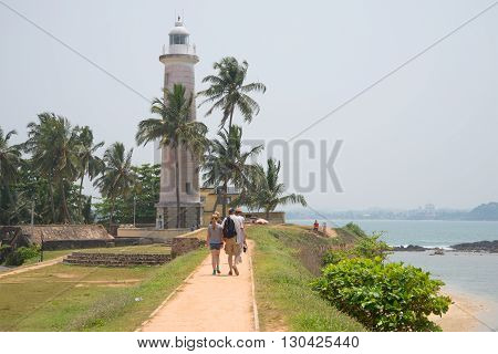 GALLE, SRI LANKA - MARCH 22, 2015: Walk along the historic waterfront fortress city of Galle. Historical landmark of the city Galle. Sri Lanka
