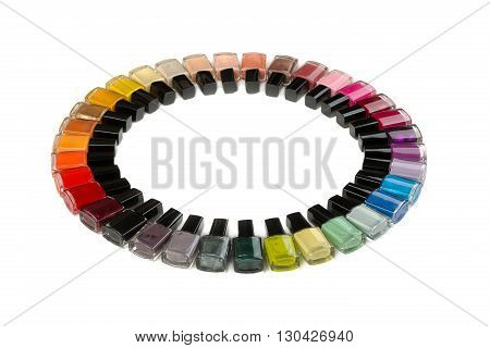 Bottles with nail polish arranged in a circle. Isolate on white.