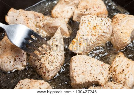 Turkey meat roasting on sunflower oil. Concept of unhealthy spicy food