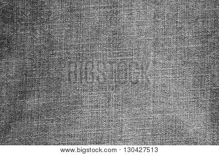 the textured background from rough cotton material or denim of pale gray color
