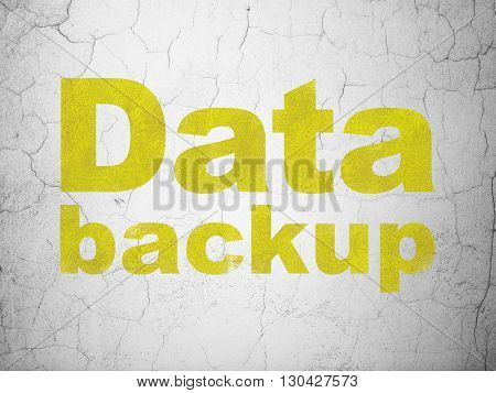Information concept: Yellow Data Backup on textured concrete wall background