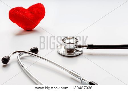 concept of life stethoscope on a white background with plush red heart soft light