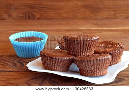 Homemade sweet pastry. Homemade tasty cupcakes on a table. Sweet muffins are made of eggs, butter, chocolate, cocoa, sugar, flour