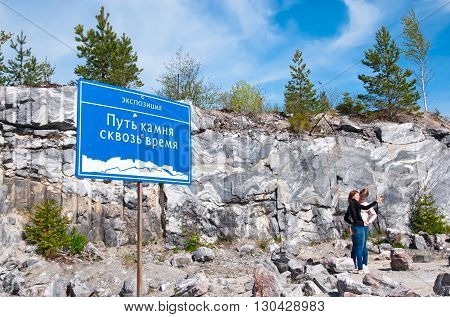RUSKEALA, KARELIA, RUSSIA - MAY 14, 2016: Tourists take pictures near Italian Quarry and Marble Lake in The Mountain Park