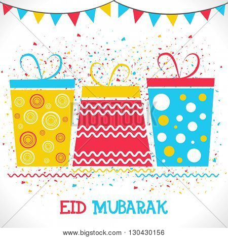 Creative colourful gifts on confetti background for Muslim Community Festival, Eid Mubarak celebration.
