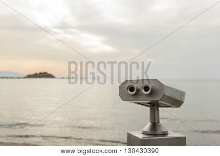 field glasses standing by the sea shore